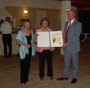 Cans For Kids President Olga Demetriades (centre) receives the Energy Globe national award for Cyprus from Austrian Ambassador Kurt Mueller
